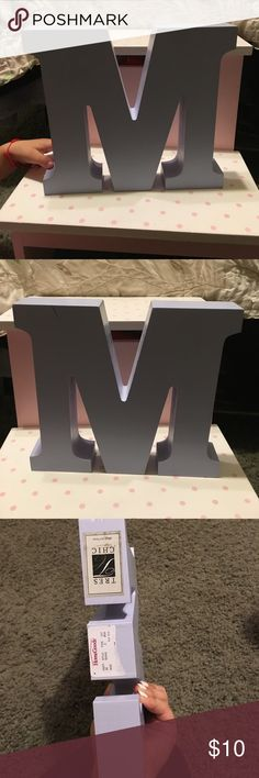 Letter decor for Kids room Very cute letter M for a child's room is a little over a pound I think LOL but is very cute looking on the shelf you can help stand books up or you can just use it to look cute in the roomis one mark on it but that's about it Other