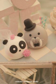 Love panda and Walrus wedding cake topper