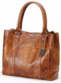 This classic tote is styled after the iconic Melissa Button boot. It's constructed of washed leather with a natural oiled pull up finish.