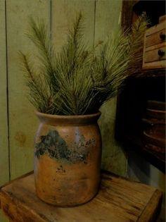Old salt-glazed crock of pine branches..