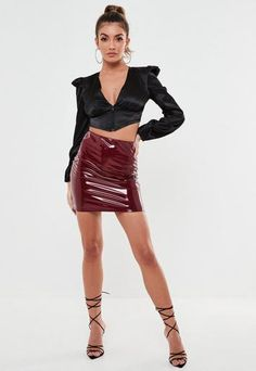 wine vinyl mini skirt with an elasticated waist.