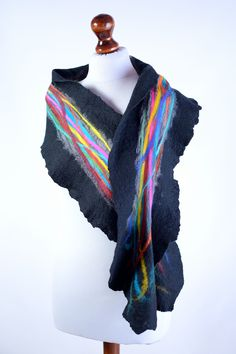 Black nuno felt scarf with colorful stripes made on the gray silk chiffon. This elegant accessory is just what you need to become a queen of the night! #black #nuno_felt_scarf #scarf #felt #wool #silk #colorful #stripes
