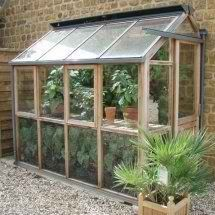 A lean to greenhouse is an attached greenhouse that is just an extension of of one part of the wall of your house. To build your own lean-to. Lean To Greenhouse Kits, Outdoor Greenhouse, Cheap Greenhouse, Backyard Greenhouse, Greenhouse Plans, Outdoor Gardens, Greenhouse Wedding, Greenhouse Attached To House, Greenhouse Frame