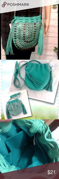 "Rue 21 Teal Boho Drawstring Tassel Crossbody Bag New with tags! NWT. Rue 21 Teal / Turquoise drawstring crossbody bag embellished with silver studs.  Inside slip pockets and zip pocket.  9 x 9.5"".   Strap drop 26"". Please ask all questions before you purchase! I'm happy to help! Sorry, no trades or holds Please, no lowball offers Please use Offer Button! Bundle for best prices! Happy Poshing! Rue 21 Bags Crossbody Bags"