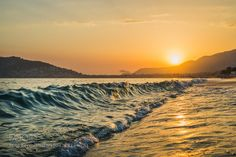 """Sunset at the beach in Alanya Turkey. View of the castle hill and sea Go to http://iBoatCity.com and use code PINTEREST for free shipping on your first order! (Lower 48 USA Only). Sign up for our email newsletter to get your free guide: """"Boat Buyer's Guide for Beginners."""""""