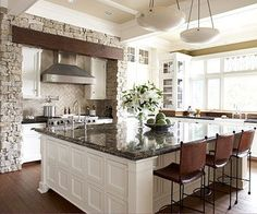 Would love to tie in brick and beams into kitchen. Love how the brick is not close enough to get splashed.