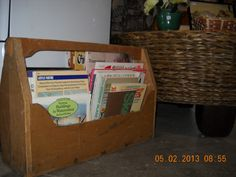Old wooden toolbox repurposed as a book caddy