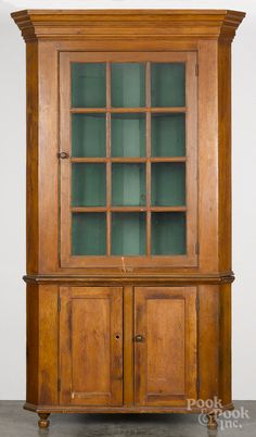 "Realized Price: $615   Pennsylvania pine two-part corner cupboard, ca. 1830, 88"" x 44""."