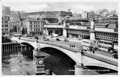 King George V Bridge, Glasgow. The King George V Bridge crosses the River Clyde here. The elevated railway line is heading into Central Station. Undated card, maybe 1950s?