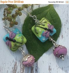 SALE Fireflies and Swirls Lampwork by WithTheseHandsCreate on Etsy