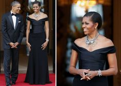 Michelle Obama's Most Spectacular Looks Ever | NicMichelle Obama's black, off-the-shoulder look is just flawless here. And that chunk of bling keeps reminding us to focus on how beautiful the tailoring is. We don't know if this counts as an LBD, because it's a gown, but we would like to redefine the term. The dress fits her like a second skin, and the resulting off-the-shoulder and waistline effect is magnificent. She wore this look to meet the queen e Rest - Part 3