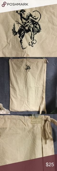 """Laundry Bag Western Cowboy Cowgirl Horse Rodeo This laundry bag has never been used. It has a cowboy on bucking horse embroidered on front, drawstring top and carrying handle. It's 100% cotton, machine washable. I thought it would be good for dirty laundry at horse shows but I never used it. Perfect gift for that hard to buy for cowboy in your life and Christmas IS right around corner!  Approximately 33"""" tall by 23"""" wide Accessories"""
