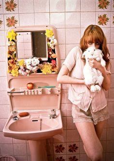 Florence Welch, vintage bathroom, and a bunny.  What's not to love?