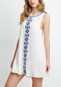 You'll definitely appreciate just how comfy this white embroidered trapeze tunic is, especially when the temperature starts to rise.
