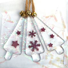 A set of 3 adorable little little fused glass Christmas tree decorations chose…