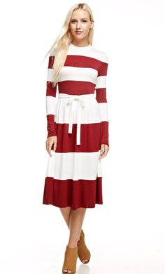 Just in time for the holidays and winter fashion, April is a classy bold striped dress with long sleeves, a modest higneckline and matching ribbon belt. This dress is a classy dress and perfect for both formal or casual wear and has a semi elastic waist giving it a classy fit and flare look.