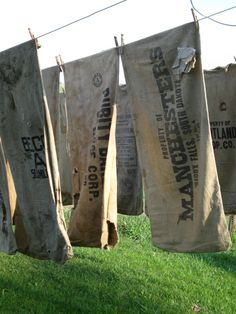 HighButtonShoe  OLD mended/stained grain sacks. Make curtains, pillows, and repurpose chairs.