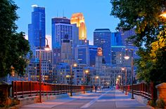 Minneapolis - Looking down the length of the Stone Arch Bridge with Minneapolis skyline at twilight