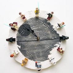 Instructable's Interchangeable Lego Star Wars Clock. Could do this with any Lego minifigs.