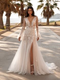Hottest Wedding Dresses Collections for best wedding dresses sexy deep v neckline with long sleeves lace boho pronovias Bohemian Wedding Dresses, Sexy Wedding Dresses, Wedding Dress Shopping, Wedding Dress Styles, Bridal Dresses, Wedding Gowns, Wedding Bride, Destination Wedding Dresses, Bohemian Weddings