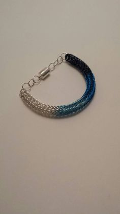 Items similar to Ombre blue Viking Knit bracelet. Unique and trendy! on Etsy Knit Bracelet, Bracelets, Viking Knit, Blue Ombre, Vikings, Turquoise Bracelet, Magnets, My Etsy Shop, Knitting