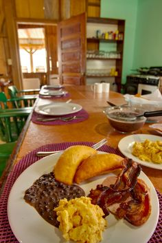 Traditional Belizean breakfast favorite, fry jacks, scrambled eggs, refried beans and crispy bacon. Is your mouth watering? #robertsgrove