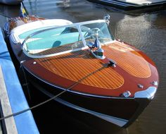 Riva speedboats - so 1950's, drive a speedboat like this one fast by myself on a lake as if I was in a movie, hee hee...