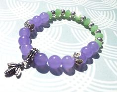 Hey, I found this really awesome Etsy listing at https://www.etsy.com/listing/281102230/bumble-bee-beaded-bracelet-lavender-jade