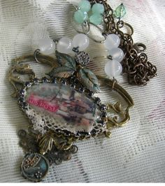 Mixed Media Assemblage Necklace - Vintage Collage Snow Scene. $85.00, via Etsy.