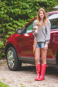 Oversized sweater and Red Rain boots