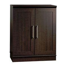 Sauder Homeplus Base Cabinet - Dakota Oak Constructed of environmentally friendly engineered wood. Dakota oak finish. Adjustable shelf behind framed panel doors. Enclosed back panel has cord access, adjustable base levelers. Dimensions: 17L x 29.63W...