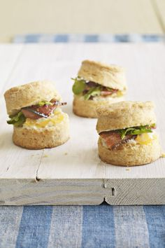 Enjoy your go-to sandwich in bite-sized form by serving tomato, mayonnaise, lettuce, and bacon between soft biscuits.