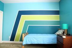 Make a HUGE impact in your bedroom with paint! These racing stripes took only minimal effort, and they completely update the look of the space! Use Frog Tape for perfect crisp and clean lines!