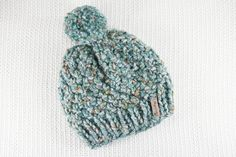This amazing chunky hat is hand knitted with thick and luxurious yarn and finished off with a fabulous large Pom Pom Bobble on top! This beanie hat in Forest Green Speckle is the perfect accessory for this winter! Bobble Hats, Chunky Wool, Mint Blue, Pom Pom Hat, Blush Roses, Winter Accessories, Beanie Hats, Hand Knitting, Wool Blend