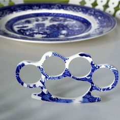 China. Knuckle ring by The Broken Plate. Old Johnson Brothers china plates.