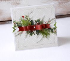 Layers of greenery with a red bow