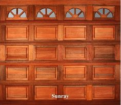 A wooden garage door in Sunray style.