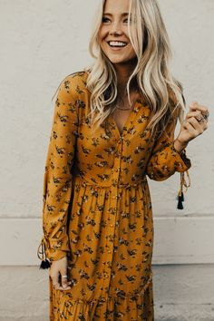 Mustard Floral Print Maxi Dress Long Sleeve w/Ribbon Tie Cuff Ruffle Hem Panels Button Up Front Fully Lined V-Neck Nursing Friendly View Size Chart Model is + Wearing a Small Backless Maxi Dresses, Modest Dresses, Cute Dresses, Casual Dresses, Maxi Skirts, Casual Outfits, Long Sleeve Floral Dress, Floral Print Maxi Dress, Dress Long