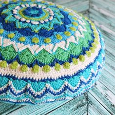 Crochet pattern for a square, mandala, and cushion based on an intricate Moroccan tile design.