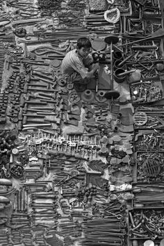 Tool Trader II by Meanest Indian on flickr        Taken from Ellis Bridge looking over a tool trader's spot at the Ravivar Bazaar (Sunday Market) in Ahmedabad. The display of tools at this particular stall is about 4 times that which you can see here and is all set up for only one day a week.
