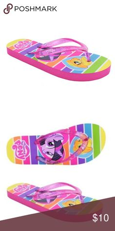 My Little Pony Girls Victoria Thong Flip Flops BRAND NEW WITH TAGS. SMOKE FREE HOME.  Complement her summer wardrobe with these My Little Pony Victoria Girls' Thong Sandals. They are made of lightweight and sturdy EVA for long term use. These adorable beach sandals for girls' have an easy-to-wear slip-on style with glitter thong. They have vibrant graphics on the inner sole that feature her favorite My Little Pony characters. These flip-flops are flexible for comfort and non-marking to…