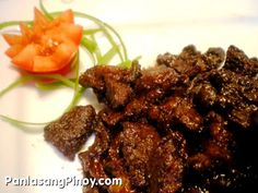 "Beef Tapa is dried cured beef similar to ""Beef Jerky"". This is traditionally prepared by curing the meat with sea salt and letting it dry directly under the sun for the purpose of preserving the meat. Nowadays, commercialized Beef Tapa are often cured but most do not undergo drying.Tapa is usually fried and is best served with vinegar.  A popular"