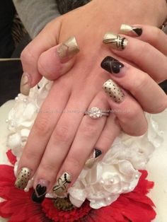 Acrylic nails with black and gold nail art by Janny Dangerous