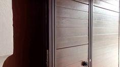 Puerta batiente con puerta peatonal incorporada motorizada con el KIT RAM 6 SP.