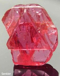 Spinel crystal  It is a precious gem of transparent red, darkish and yellowish red. Red color of spinel is so close to ruby that quite a few spinels were wrongly mistaken as rubies in the past.  Ruby popularly known as 'Black Prince' among the jewels of the British Brown is not actually a ruby but it is a red spinel.  Spinel is good for financial gains and protects the wearer against unforeseen losses.