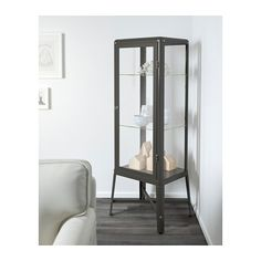 For storage behind sofa upon entry to fam room.  FABRIKÖR Glass-door cabinet - dark gray - IKEA