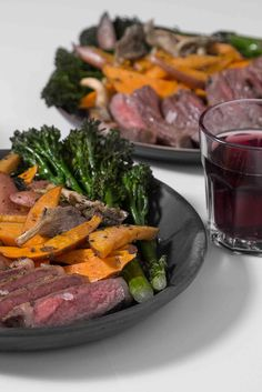 Make a romantic dinner for two all on one sheet pan by roasting New York strip steaks surrounded by sweet potatoes and broccolini in herb butter.
