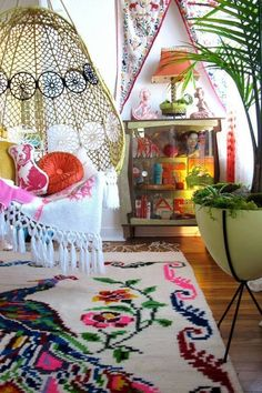 Sit back and relax like a hippie in a space brightened by statement-making colors and a crochet hammock chair.