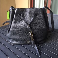 Kate Spade Black Cooper Bucket Bag Grey Street NWT Kate Spade Black Cooper Bucket Bag Grey Street. Great everyday purse. Can be used over the shoulder or as a crossbody as pictured. kate spade Bags