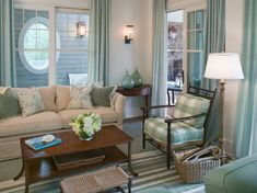 House of Turquoise: Tammy Connor Interior Design // living room // pale blue-green window panels with matching pillow accents // green and blue glass bottles